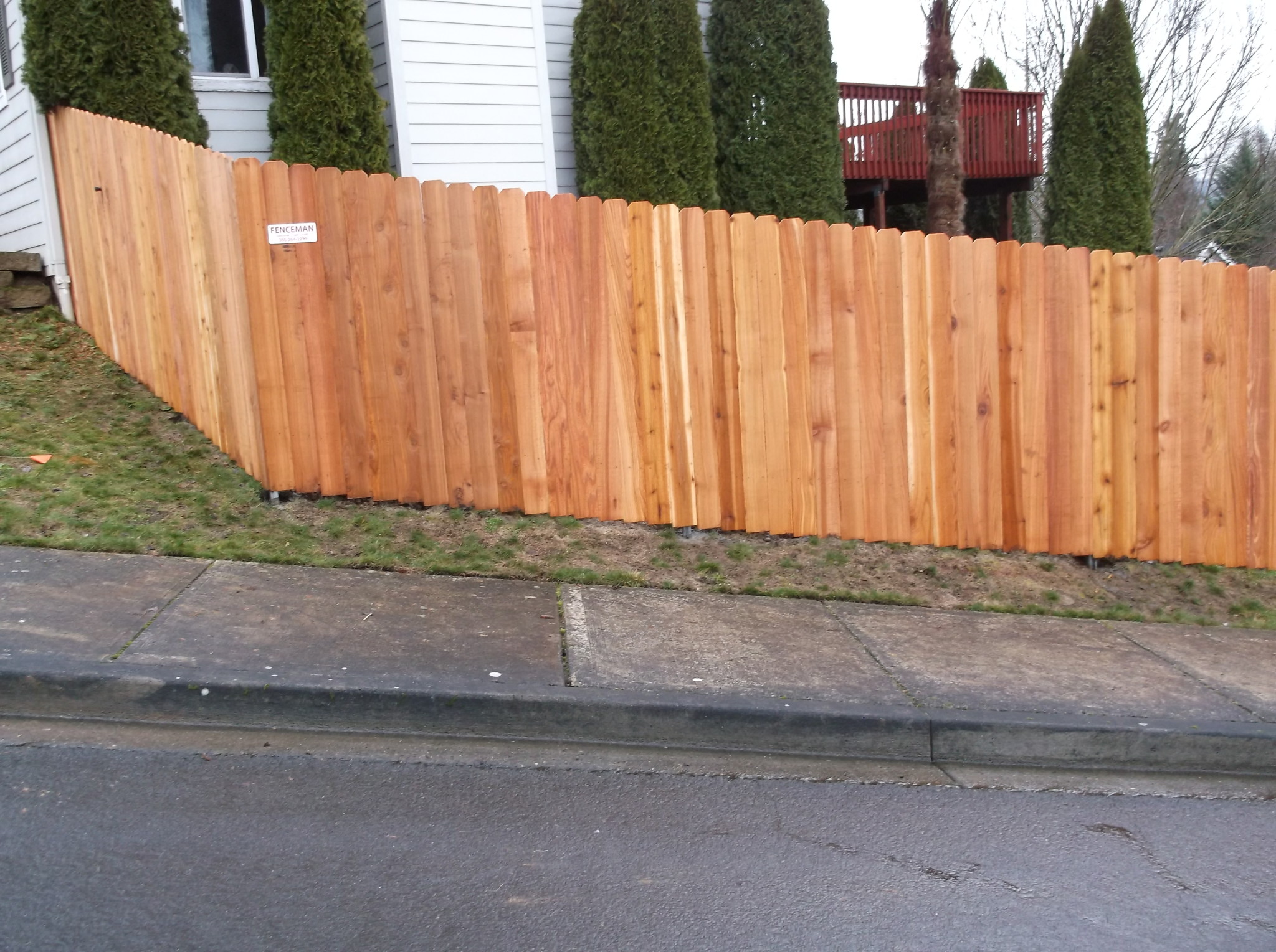 Dog Eared Fence Follows Contours of the property. Contact Vancouver's Best Fence Builders. The Fenceman Fence Company installs wood, vinyl, chain link and ornamental iron fences. We also offer materials for the do it yourselfer.