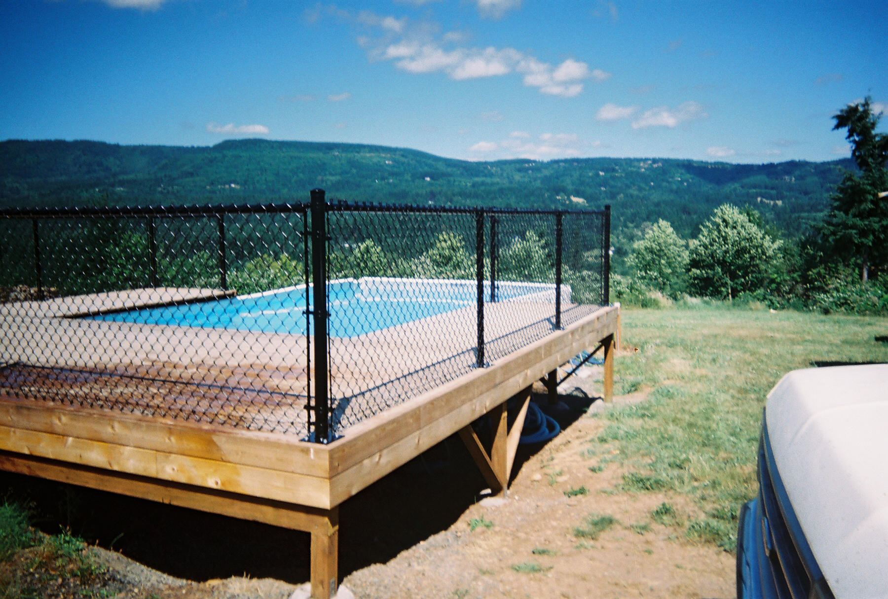 Black Vinyl chain link fence with flange post adds safety without obstructing your view. Contact Vancouver Washington's Best Fence Builders. The Fenceman Fence Company installs wood, vinyl, chain link and ornamental iron fences. We also offer materials for the do it yourselfer.