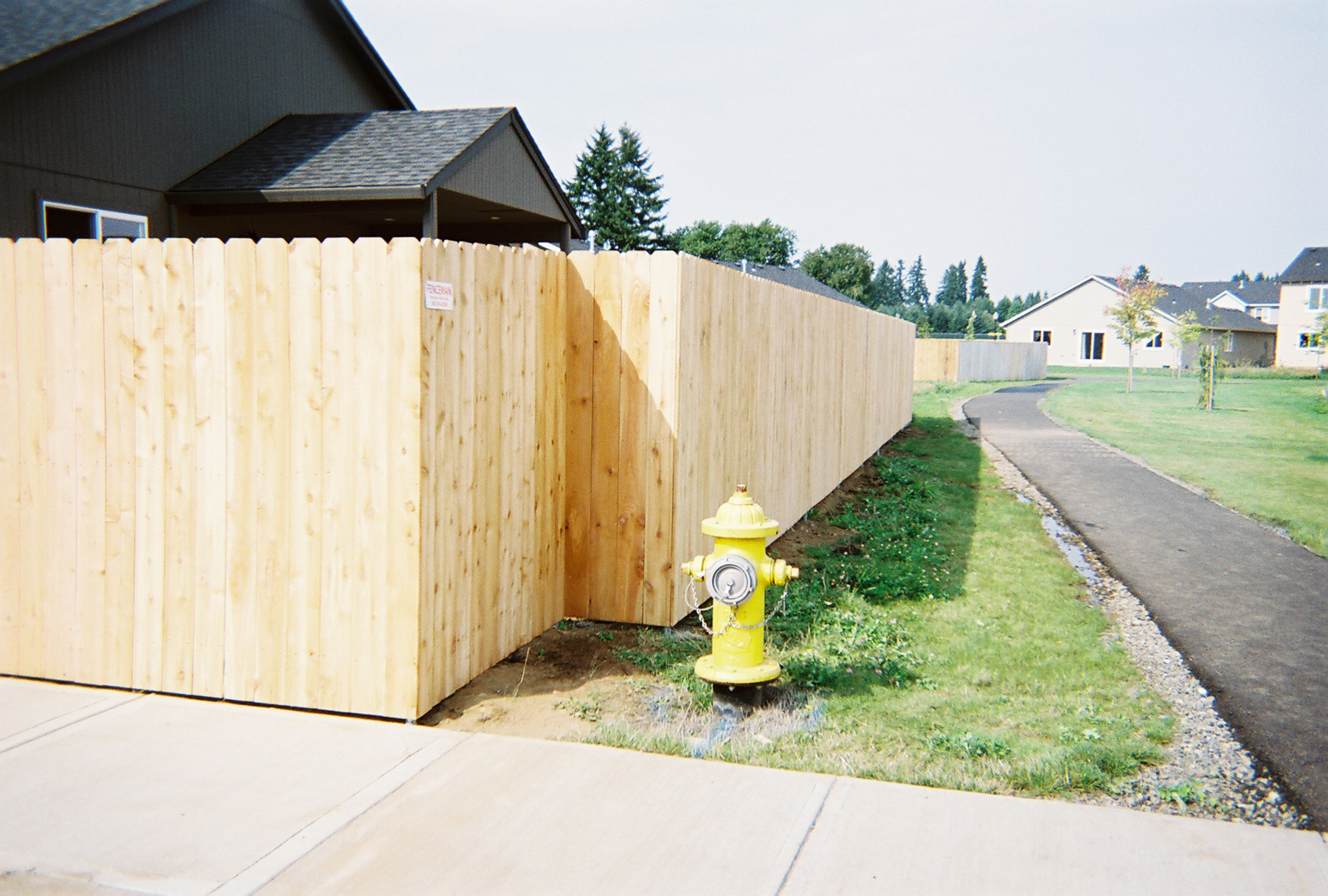 Dog Eared Solid Fence providing privacy and security. We offer fence solutions and make sure that your fence is compliant with property easements. Contact Vancouver Washington's Best Fence Builders. The Fenceman Fence Company installs wood, vinyl, chain link and ornamental iron fences. We also offer materials for the do it yourselfer.
