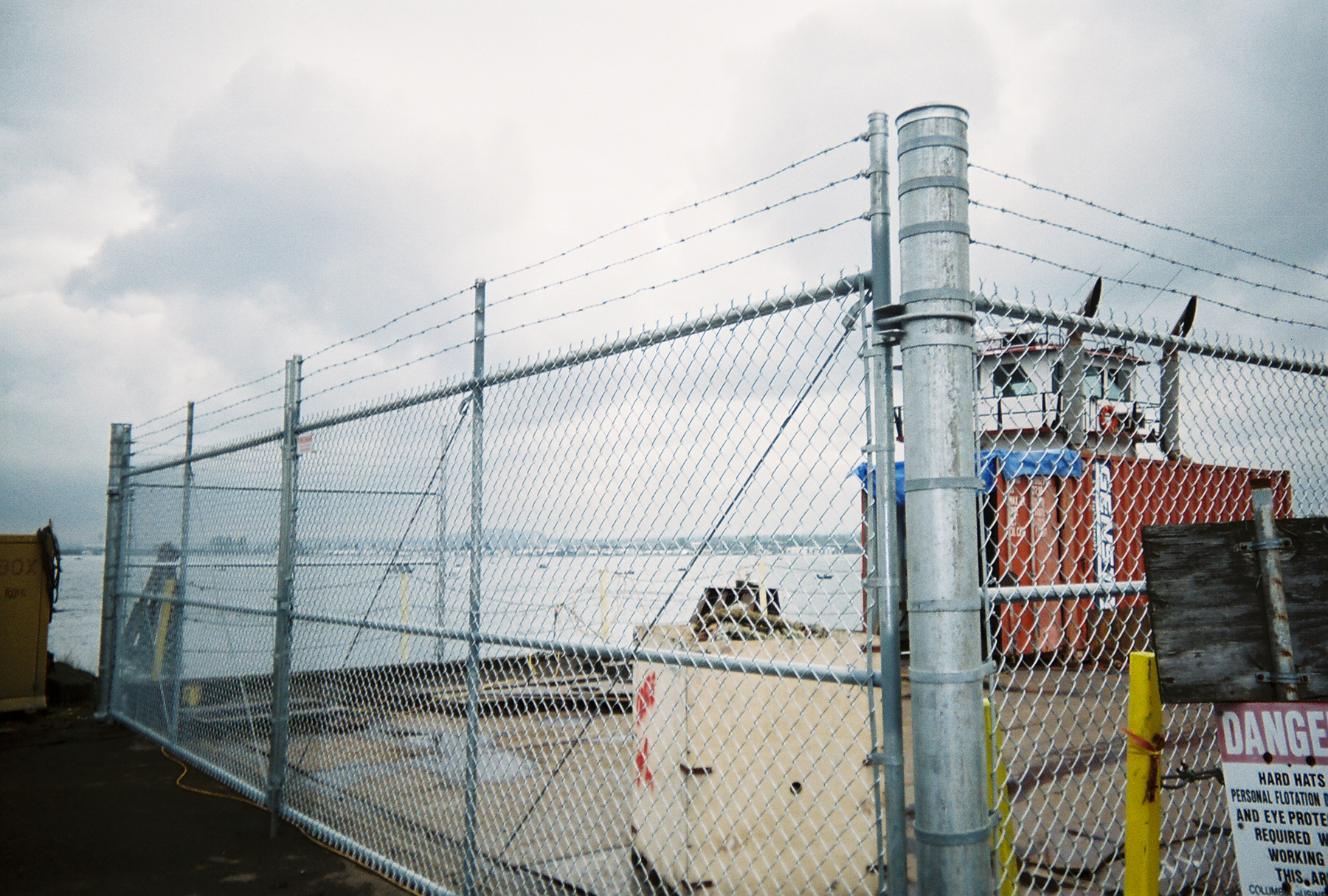 Industrial Strength Chain Link Fence providing security for valuable cargo being off loaded from ship. Contact Vancouver Washington's Best Fence Builders. Providing the best for commercial or residential fence needs. Call: 360-254-2299 today