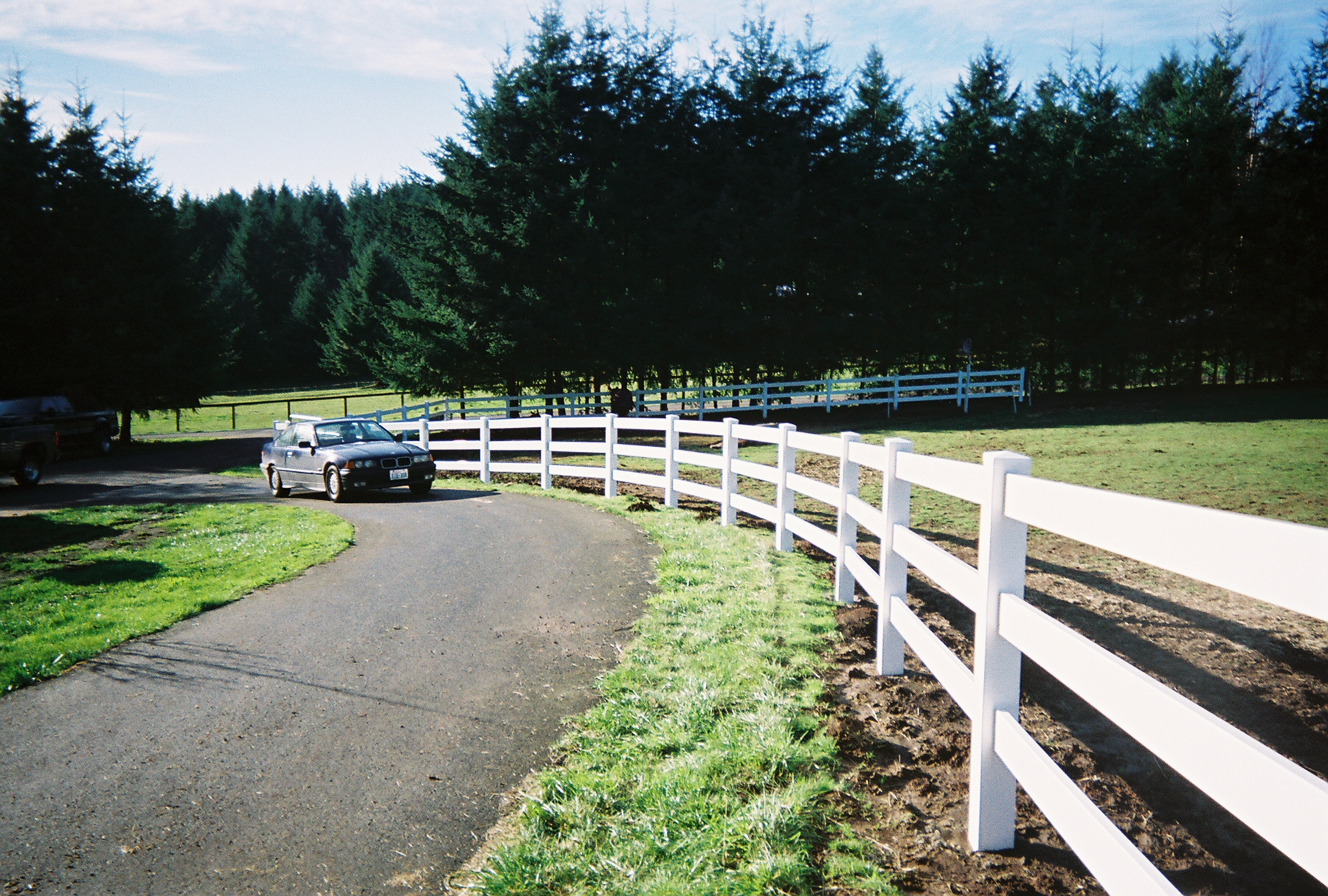 3 Rail white vinyl fence, enhancing the surroundings. Contact Vancouver Washington's Best Fence Builders. The Fenceman Fence Company installs wood, vinyl, chain link and ornamental iron fences. We also offer materials for the do it yourselfer.