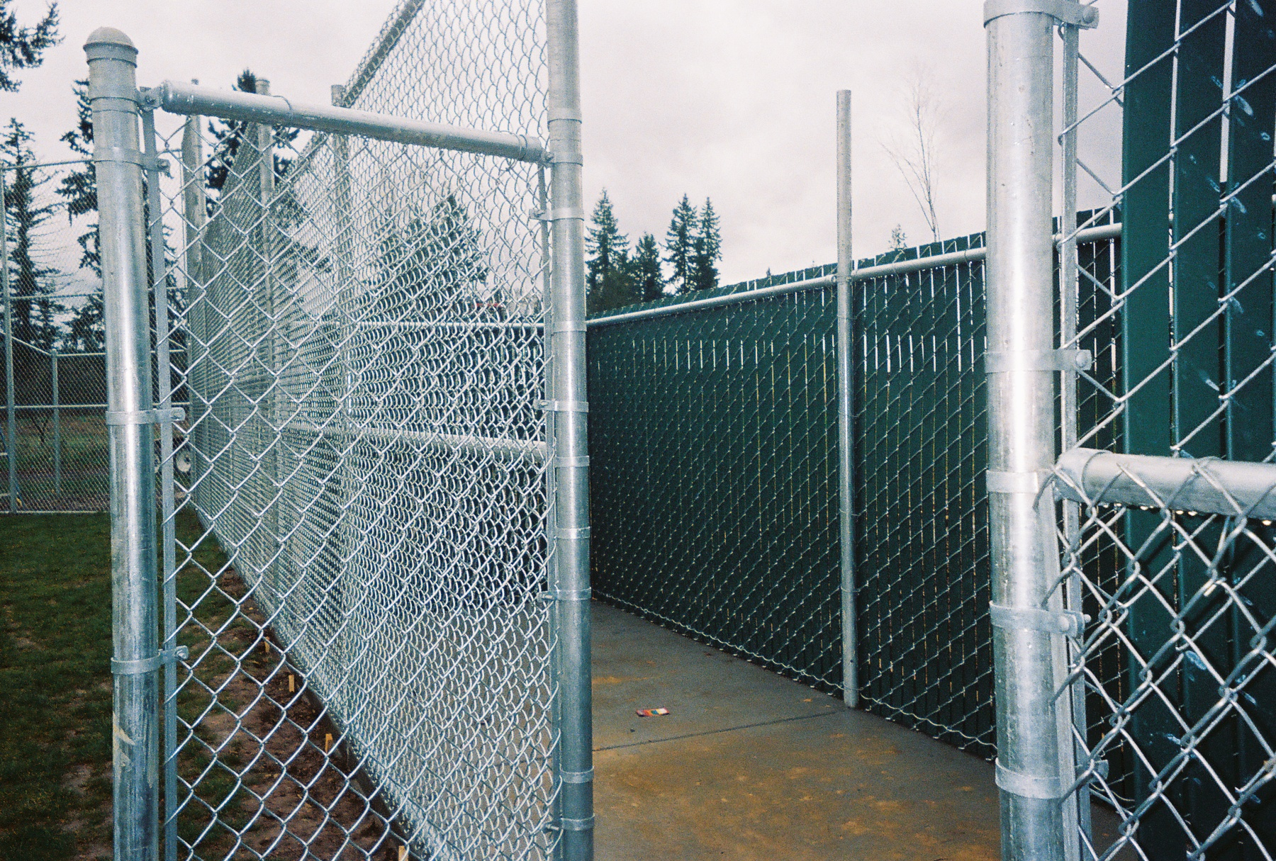 Green Pre-slatted Chain link fencing. Contact Vancouver Washington's Best Fence Builders. The Fenceman Fence Company installs wood, vinyl, chain link and ornamental iron fences. We also offer materials for the do it yourselfer