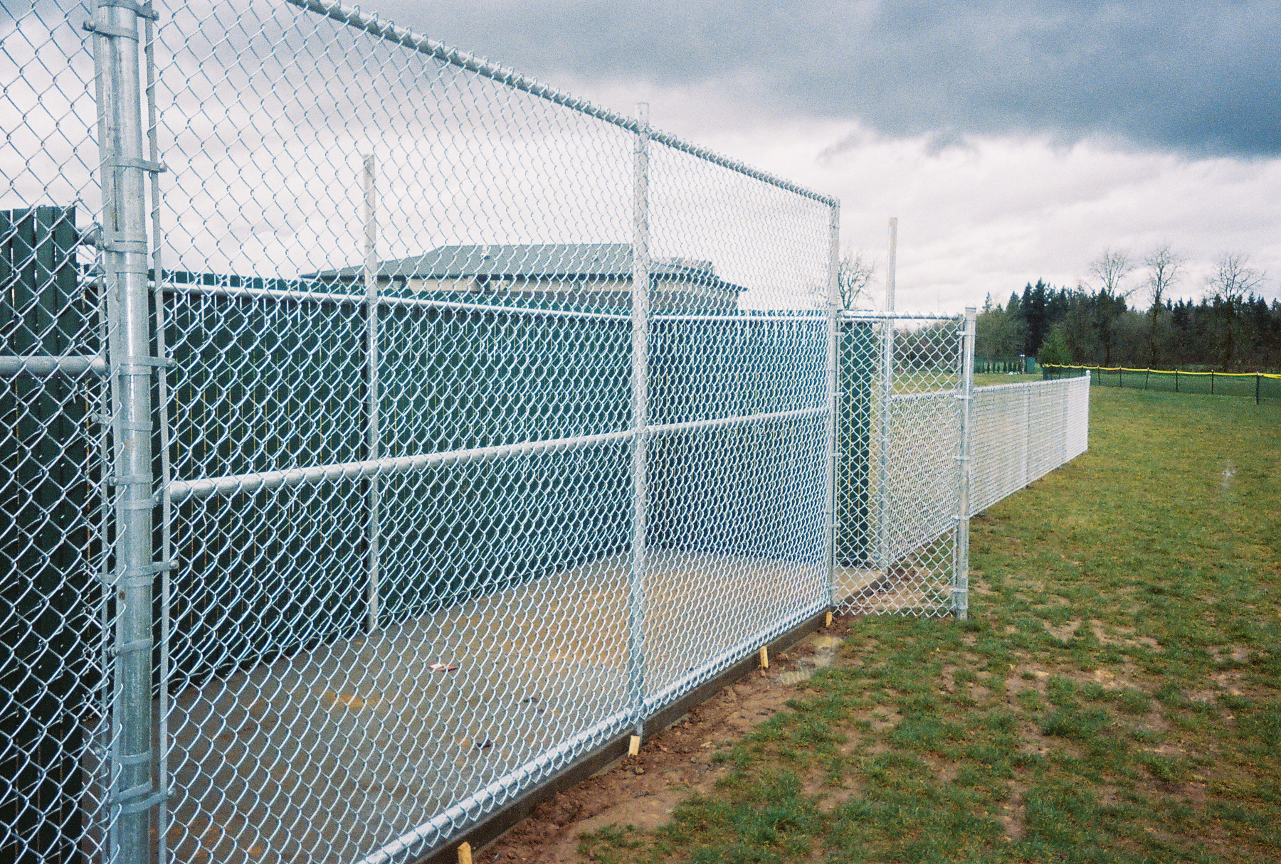 Galvanized Chain Link pitcher warm area again providing safety for players and spectators. Contact Vancouver Washington's Best Fence Builders. The Fenceman Fence Company installs wood, vinyl, chain link and ornamental iron fences. We also offer materials for the do it yourselfer.