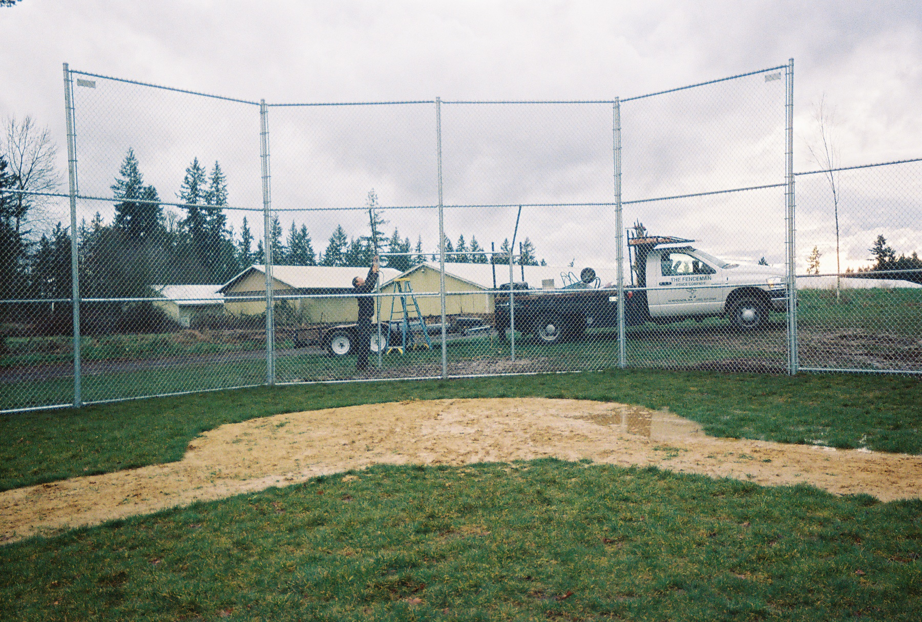Preparing for the first pitch. Contact Vancouver Washington's Best Fence Builders. The Fenceman Fence Company installs wood, vinyl, chain link and ornamental iron fences. We also offer materials for the do it yourselfer.
