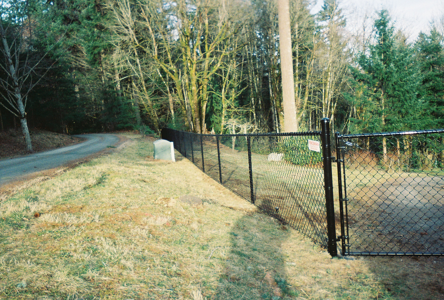 Black Vinyl Chain Link Fence flows harmoniously with the surrounding scenery. Contact Vancouver Washington's Best Fence Builders. The Fenceman Fence Company installs wood, vinyl, chain link and ornamental iron fences. We also offer materials for the do it yourselfer.