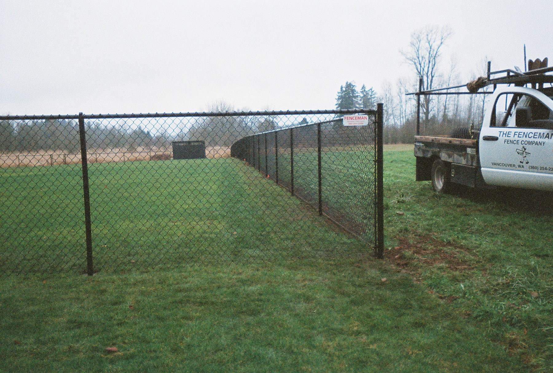 Black Vinyl Chain Link Fence, providing both security and beauty without the added expense of ornamental construction. Contact Vancouver Washington's Best Fence Builders. The Fenceman Fence Company installs wood, vinyl, chain link and ornamental iron fences. We also offer materials for the do it yourselfer.