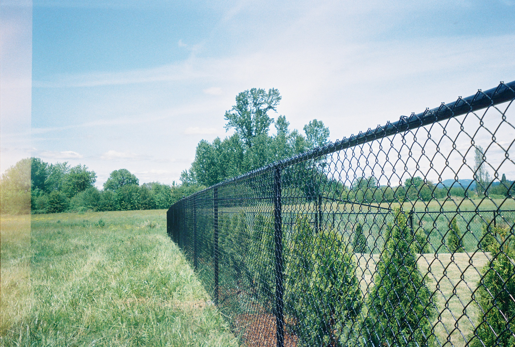 Black Vinyl chain link fence blends perfectlyl with all types of landscaping. Contact Vancouver Washington's Best Fence Builders. The Fenceman Fence Company installs wood, vinyl, chain link and ornamental iron fences. We also offer materials for the do it yourselfer.