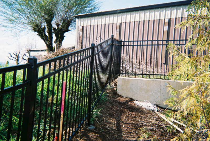 Latest Technology in ornamental fence allows contour change without direct steps. Contact Vancouver Washington's Best Fence Builders. Providing the best in all your fence needs for over 35 years. Call: 360-254-2299 today