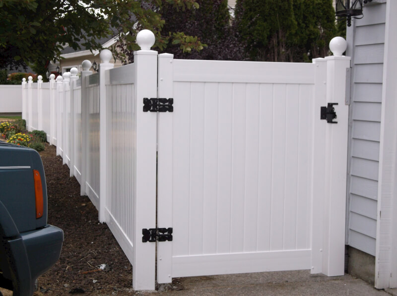 White Vinyl Walk Gate. The Fenceman Fence Company installs wood, vinyl, chain link and ornamental iron fences. We also offer materials for the do it yourselfer.