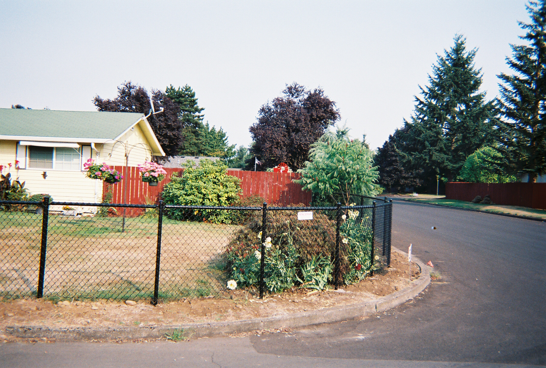 Custom Radius Black Chain link adding curb appeal, thus increasing the value of your home. Contact Vancouver Washington's Best Fence Builders. The Fenceman Fence Company installs wood, vinyl, chain link and ornamental iron fences. We also offer materials for the do it yourselfer.