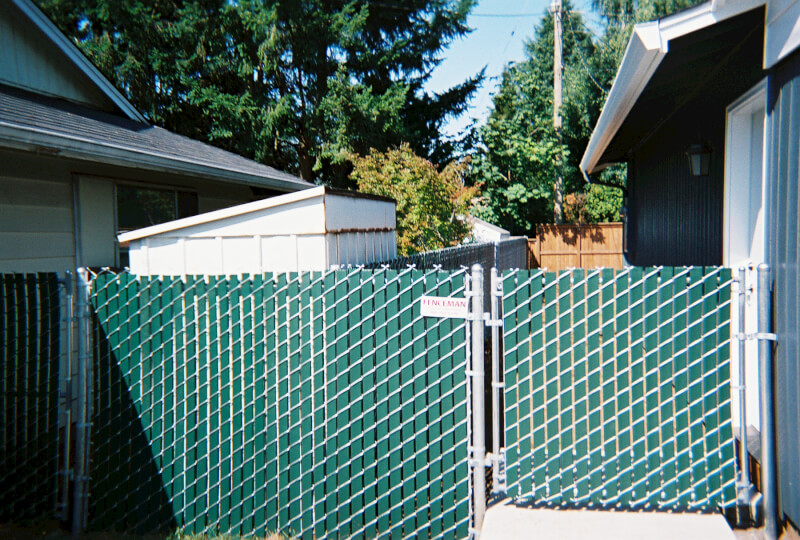 Pre-Slatted Chain Link and Walk Gate. The Fenceman Fence Company installs wood, vinyl, chain link and ornamental iron fences. We also offer materials for the do it yourselfer.