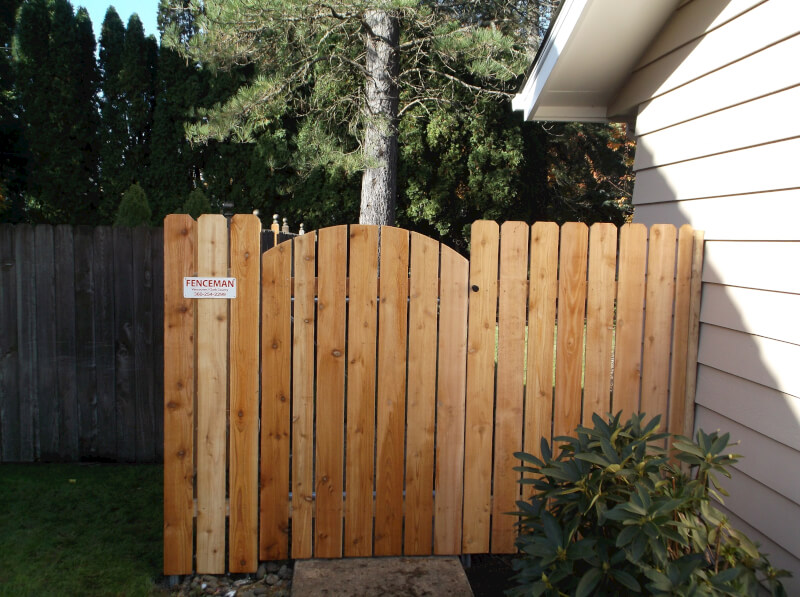 Space your gate so your dog can see out. The Fenceman Fence Company installs wood, vinyl, chain link and ornamental iron fences. We also offer materials for the do it yourselfer.