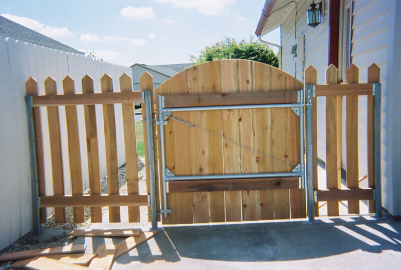 Inside View Steel Frame Gate. The Fenceman Fence Company installs wood, vinyl, chain link and ornamental iron fences. We also offer materials for the do it yourselfer.