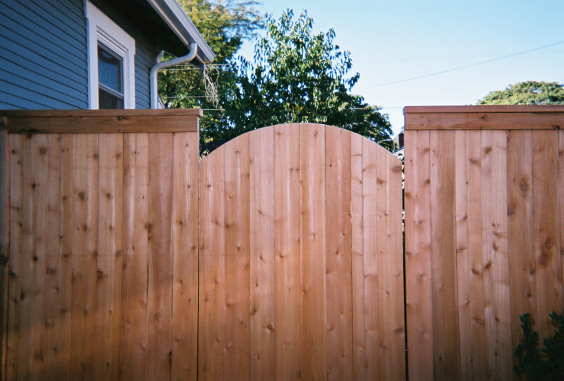 Top Cap fence with Arch gate without seeing steel frame work. The Fenceman Fence Company installs wood, vinyl, chain link and ornamental iron fences. We also offer materials for the do it yourselfer.