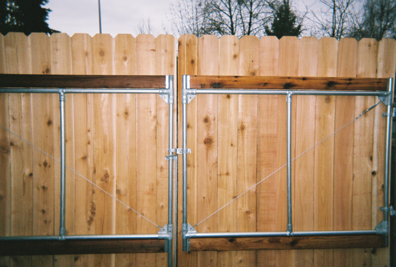 Steel frame work for RV access gate. The Fenceman Fence Company installs wood, vinyl, chain link and ornamental iron fences. We also offer materials for the do it yourselfer.