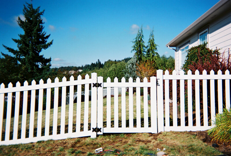 White Vinyl Picket Gate. The Fenceman Fence Company installs wood, vinyl, chain link and ornamental iron fences. We also offer materials for the do it yourselfer.