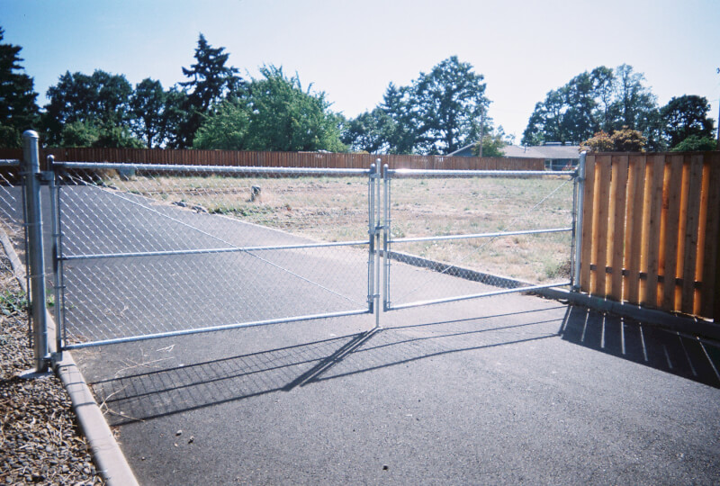 Custom weld frame chain link gate. The Fenceman Fence Company installs wood, vinyl, chain link and ornamental iron fences. We also offer materials for the do it yourselfer.
